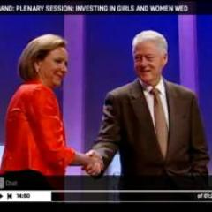 Rosario Perez shakes hands with President Clinton