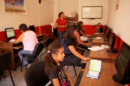 Clients and their children participate in a computer training course using Microsoft products at a Pro Mujer center in Mexico.